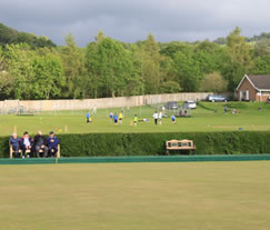 Llanidloes Bowling Club with Llanidloes Cricket Club in the Background